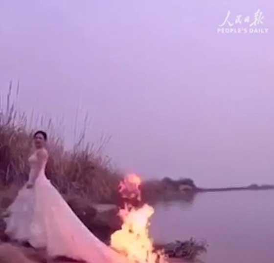 مصور يشعل النار في فستان عروس مجنونة لالتقاط اجمل صورة!! صورة رقم 2