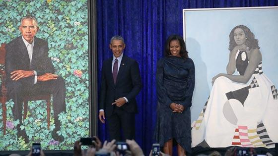 صورة رقم 1 - اوباما يسخر من شكله ويتغزل في صورة زوجته ميشيل