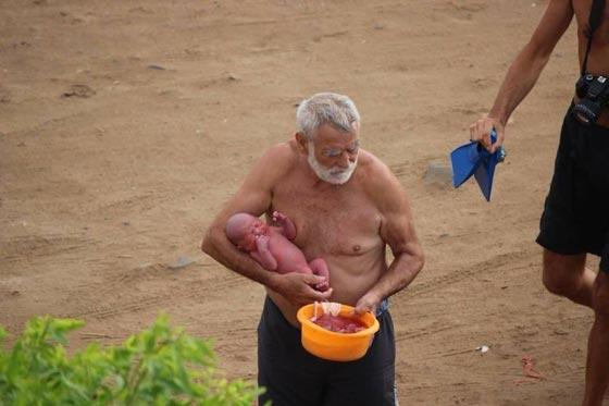 صور مدهشة.. سائحة روسية تضع مولودها وهي تسبح في البحر صورة رقم 4
