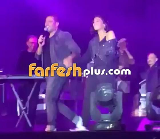 تسريب فيديو لعمرو دياب على المسرح يقبّل دينا الشربيني ويهمس (بحبك) صورة رقم 12