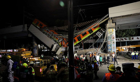 صورة رقم 24 - سقوط قطار على السيارات.. قتلى وجرحى بانهيار جسر معلق بالمكسيك!