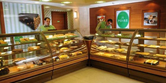 بسبب عائلة الحاج متولي.. أسرة نور الشريف تقاضي محلات حلوى صورة رقم 2