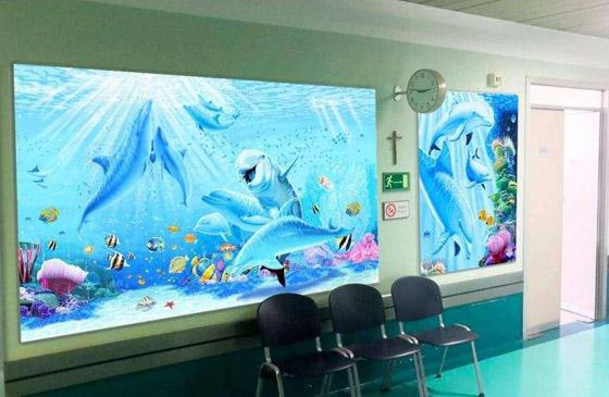 صورة رقم 1 - كيف حول فنان إيطالي مستشفى كئيبا إلى جنة للأطفال؟