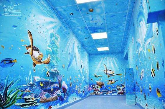 صورة رقم 2 - كيف حول فنان إيطالي مستشفى كئيبا إلى جنة للأطفال؟