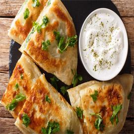 إليكم طريقة تحضير خبز البولاني المحشو على الطريقة الأفغانية الشهيرة