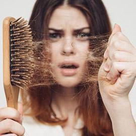 أطعمة تتسبب بتساقط الشعر