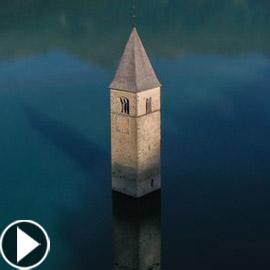 فيديو وصور: ظهور قرية إيطالية غارقة من تحت الماء بعد 70 عاما!