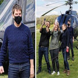صور: توم كروز يفاجئ عائلة بريطانية ويهبط بطائرته في حديقة بيتهم..  ..
