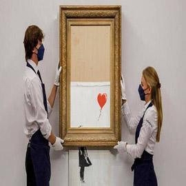 """بأضعاف سعرها المتوقع.. لوحة """"الفتاة مع البالون"""" التي """"مزّقت نفسها""""  .."""