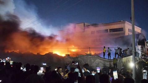 """""""كنا نسمع صراخهم وهم يختنقون"""".. شهادات مؤلمة عن ضحايا حريق مستشفى الحسين بالعراق"""