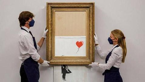 """بأضعاف سعرها المتوقع.. لوحة """"الفتاة مع البالون"""" التي """"مزّقت نفسها"""" تُباع بمبلغ ضخم في لندن"""